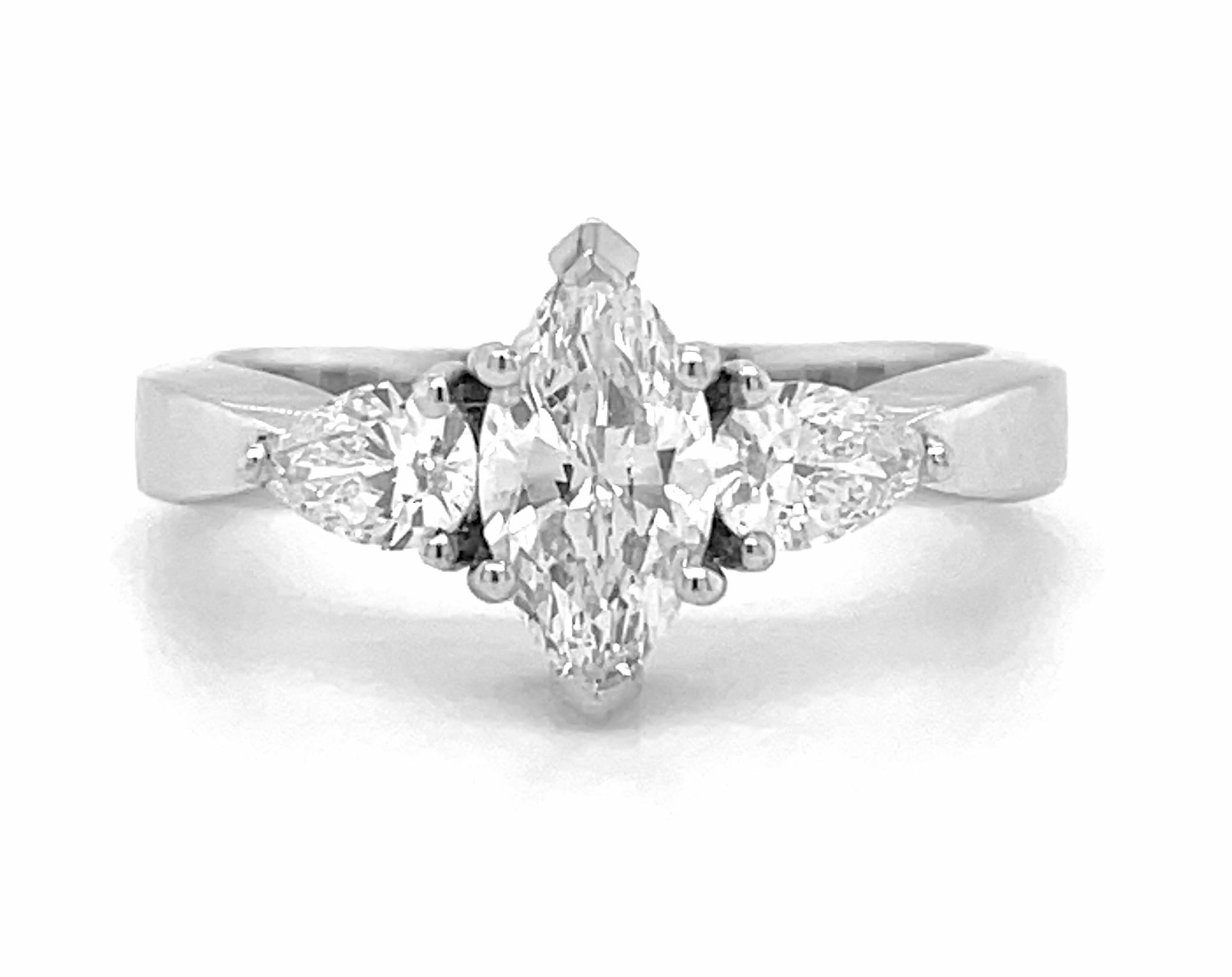 18k White Gold 3 Stone Marquise & Pearshape Diamond Ring