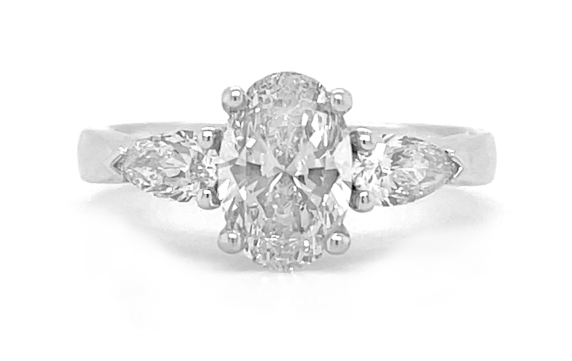 18k White Gold 3 Stone Oval & Pearshape Diamond Ring