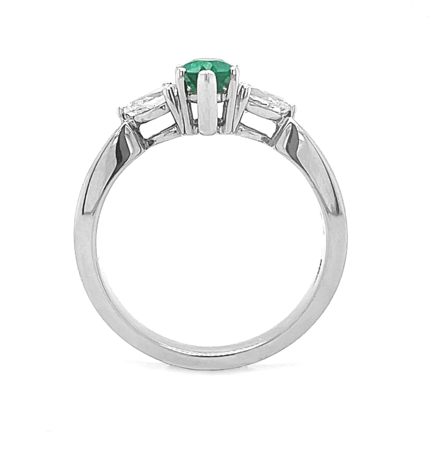 18k White Gold 3 Stone Marquise Emerald & Pearshape Diamond Ring