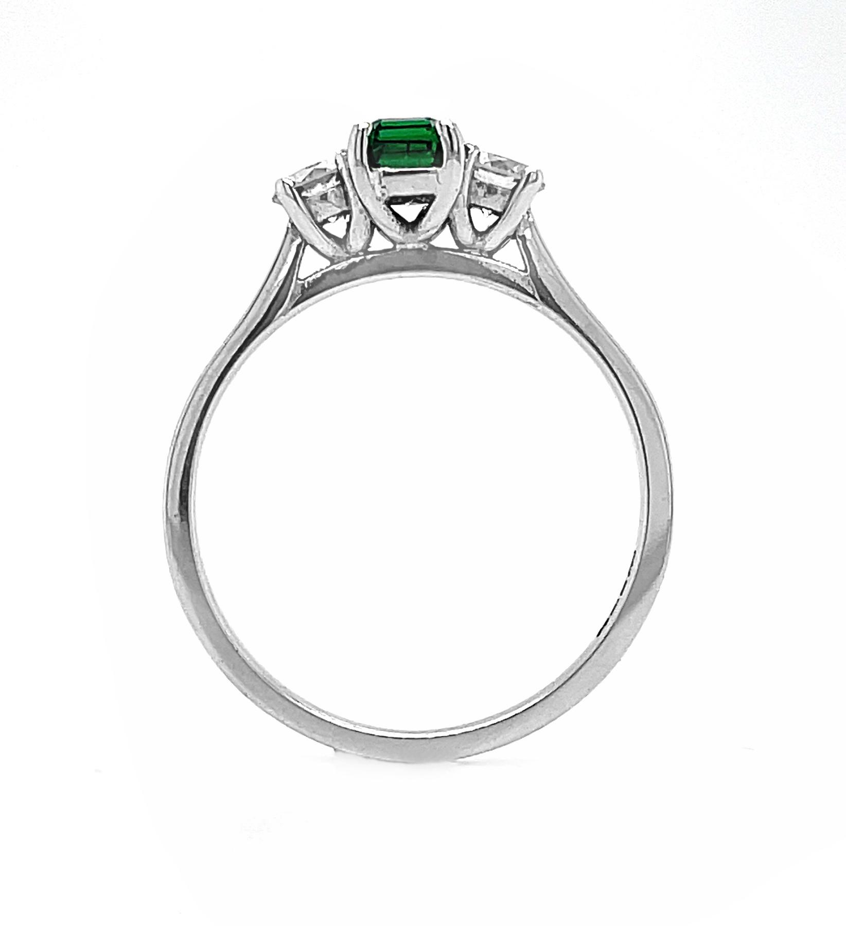 18k White Gold 3 Stone Octagonal Emerald & Brilliant Cut Diamond Ring