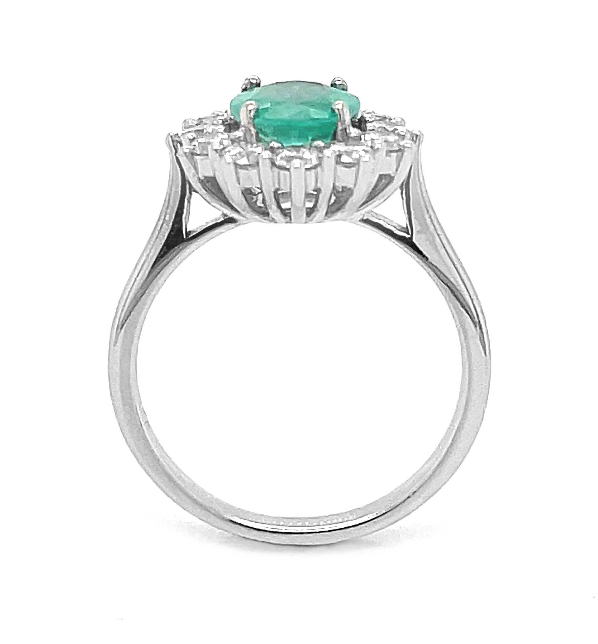 Platinum Oval Emerald & Brilliant Cut Diamond Cluster Ring