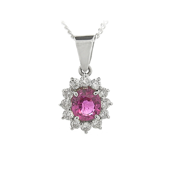 Oval Ruby And Diamond Cluster Pendant In 18k White Gold On Chain